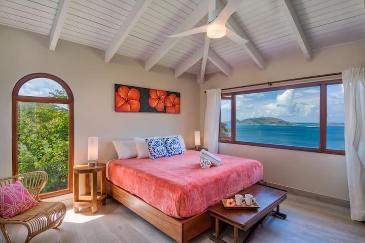 master bedroom with both garden and ocean view