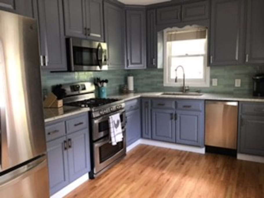 Updated kitchen with Keurig, double oven, dishwasher, refrigerator, and microwave