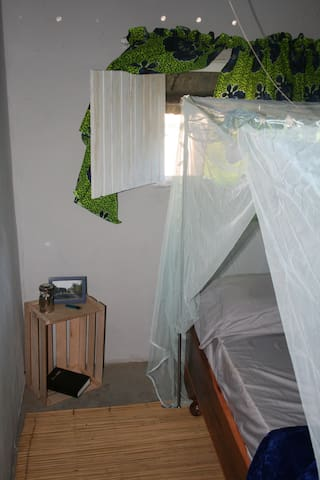 Complete with screens on windows & mosquito nets on beds.