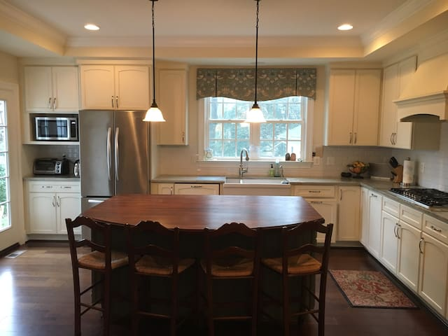 Large island and updated appliances.  Gas range.  Lots of light.