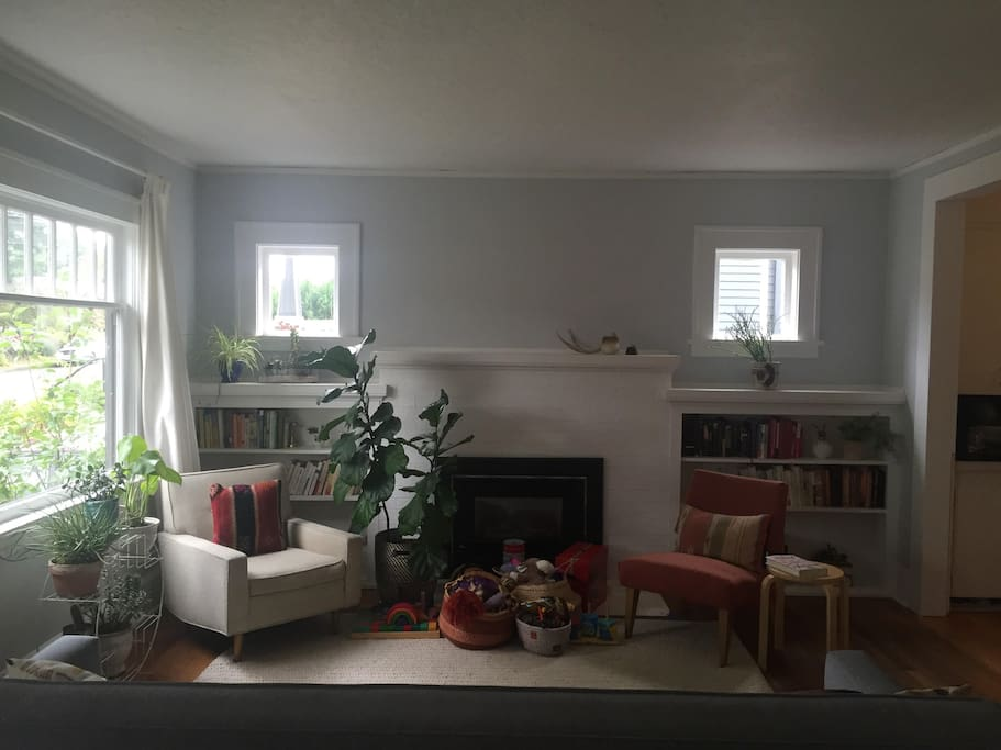 Light and plant filled, cozy living room.