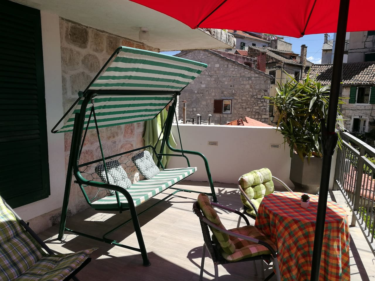 Sunny terrace with little sea view where you can enjoy every morning and night