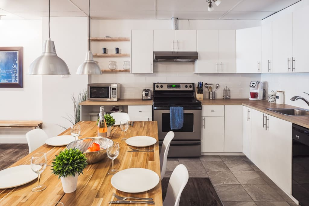 Fully equipped kitchen with Keurig coffee machine and cups