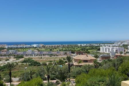 Almerimar apartment with golf course and sea views
