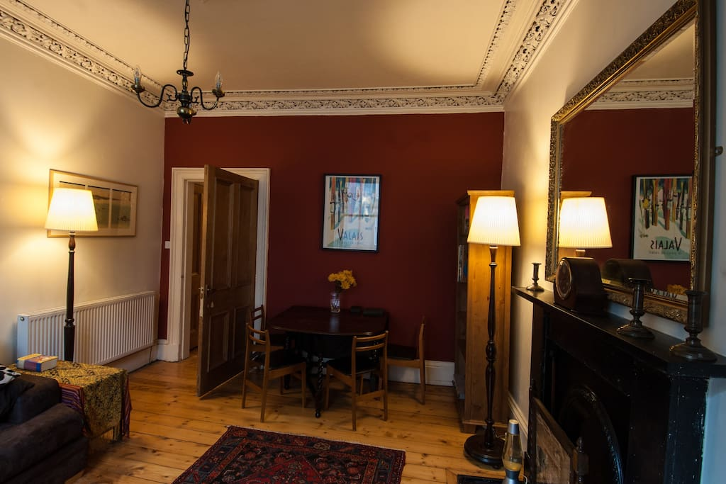 Cosy sitting room complete with traditional cornice work.