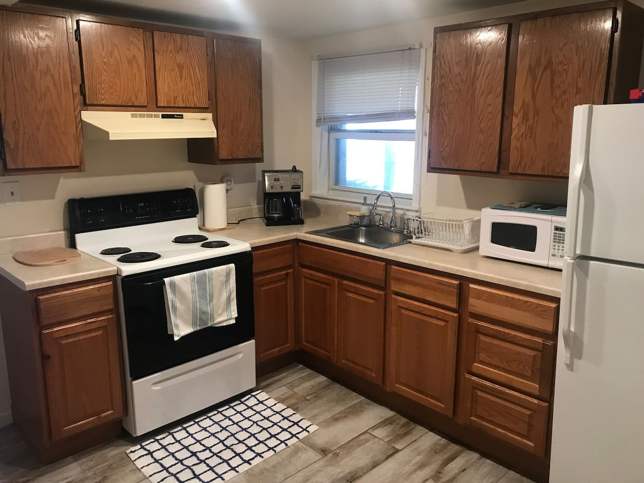 This is our kitchen as you enter the unit. We have a coffee machine with hot water dispenser. We have coffee and tee on hand with raw sugar and honey.  We have pots, pans, silverware, dishes glasses, mugs and cooking utensils for you.