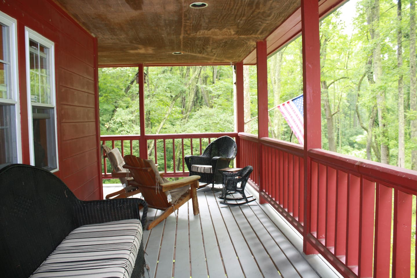 Enjoy the great outdoors from the comforts of the Red Roost and its expansive porch.