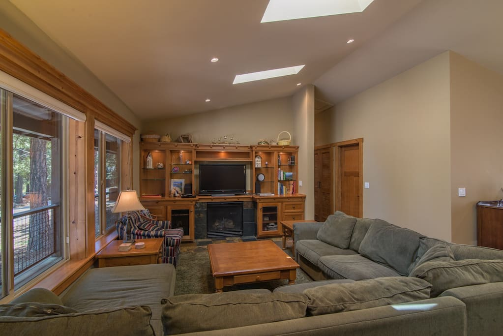 Living Room Area w/Comfy Couches, Fireplace, Large Windows, and Flat Screen TV