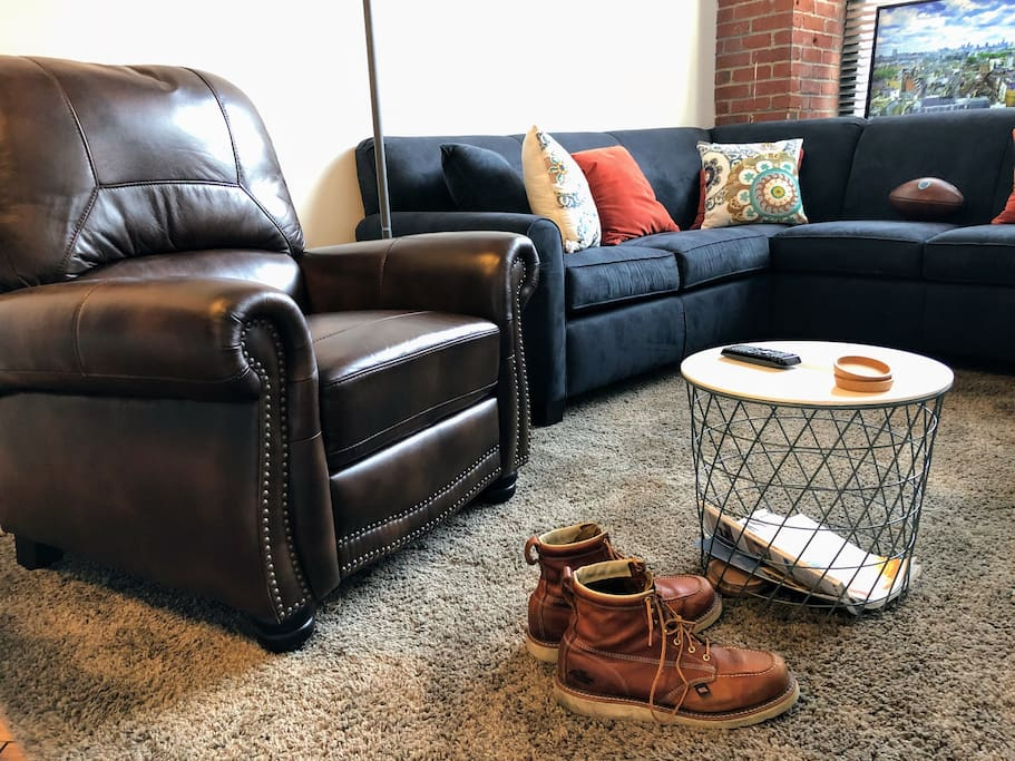 Kick your feet up and relax on the plush sectional or the leather recliner