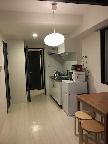 都市中心精致一室一厅高级公寓、可直达空港。您在异国的家。 - 大阪市中央区