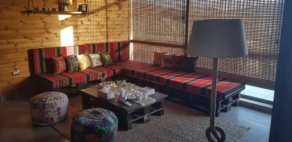 Sofa set at living area in the chalet