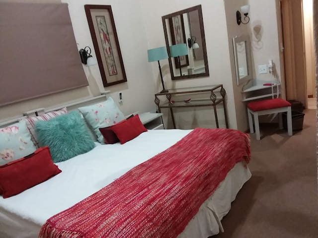 Main Bedroom. king size bed, with airconditioner, ceiling fan, mosquito screens, cupboards and bathroom ensuite,