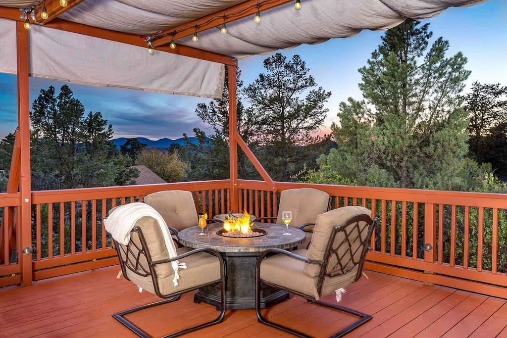 Enjoy a glass of wine by the fire while overlooking the stunning mountain view!