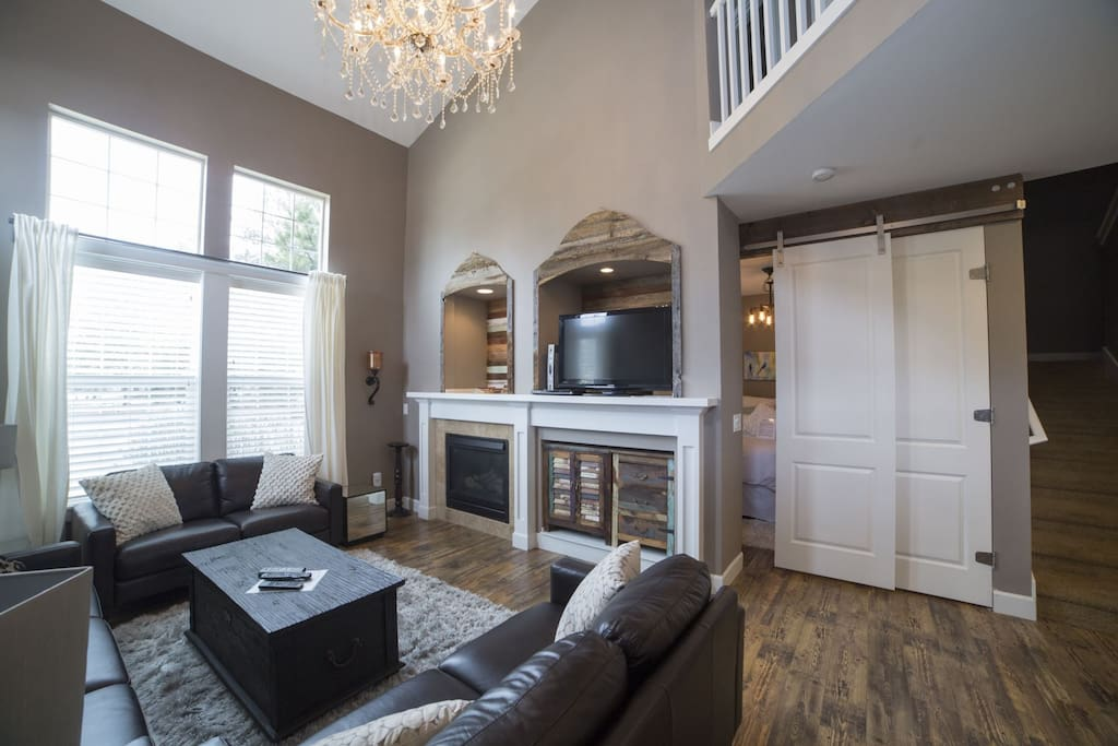 Open and social, living room with sectional sofa, fireplace, newly remodeled all throughout home