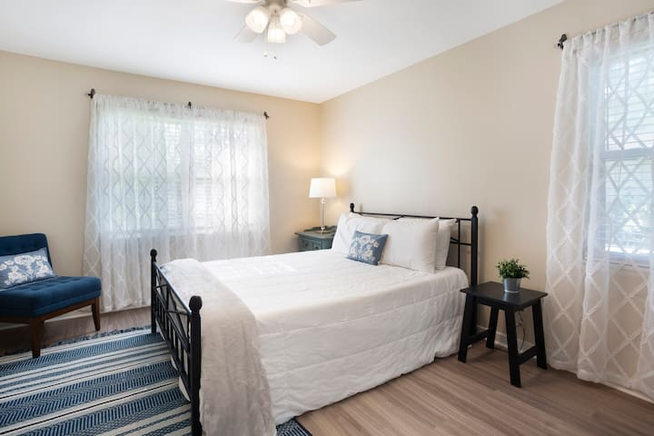 Master bedroom with queen bed, smart tv and full size closet