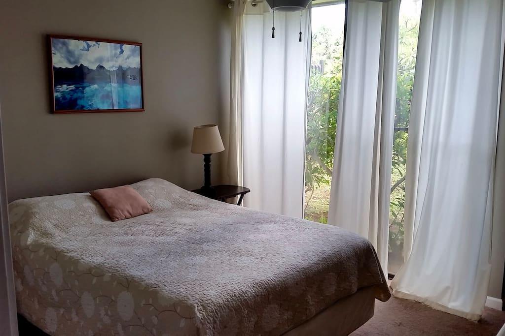 Bedroom with closet, AC, smart TV, queen bed