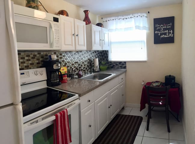 Kitchen with microwave, coffee maker, stove,  full-size refrigerator