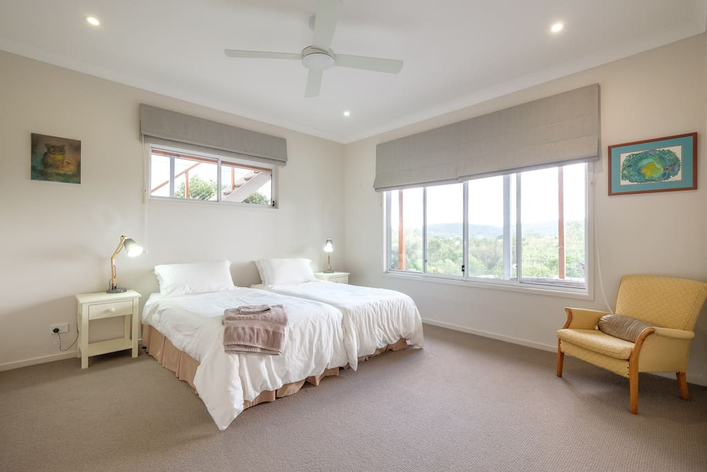 Large second bedroom with 2 single beds and views towards park and Enoggera Dam.