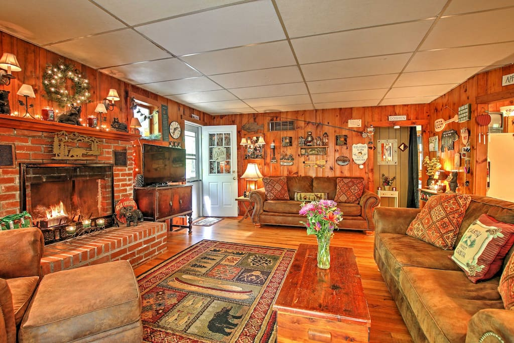 The cabin features an open-concept design and rustic decor.