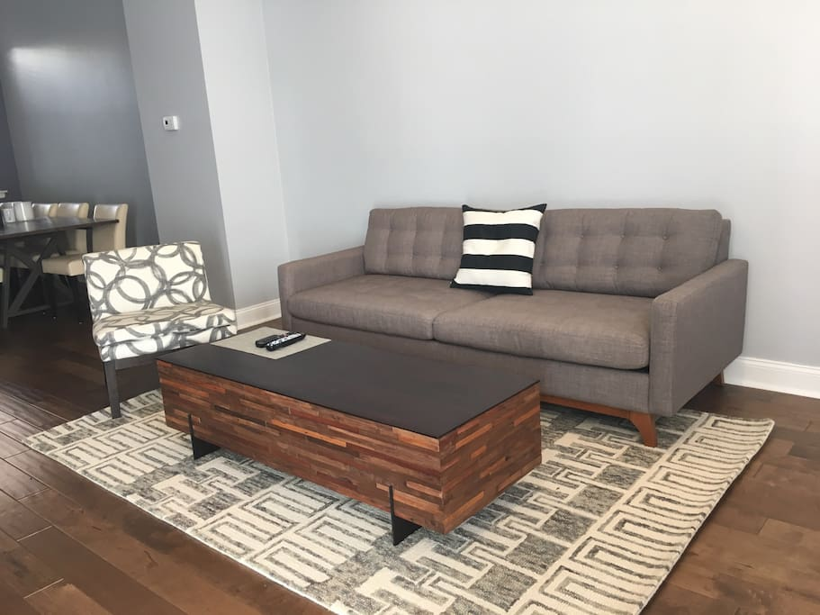 Kick back on the comfortable living space and watch ...