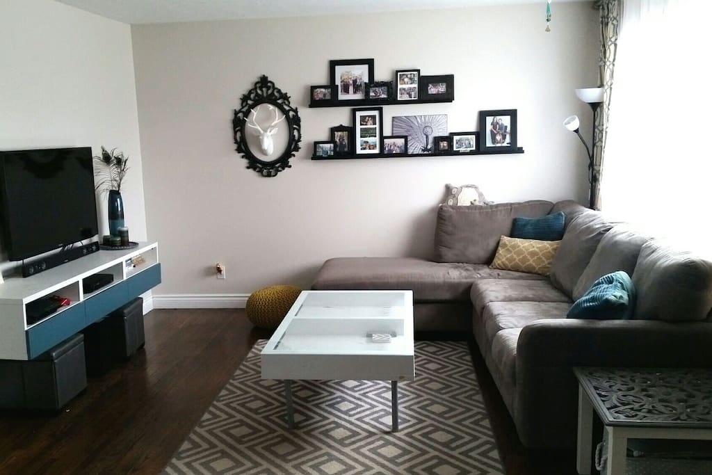 """Living room with 46"""" flat screen TV. Relax and unwind on the large sectional."""