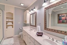 Freshen up in the en-suite bathroom with dual sinks and walk-in shower.