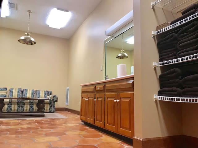 Men's showers and locker area with restrooms and sinks.