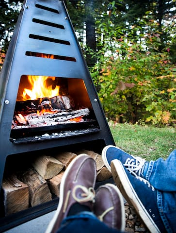 Relax, have a drink and snuggle into cozy Adirondack chairs in front of a Fun & Modern outdoor fireplace