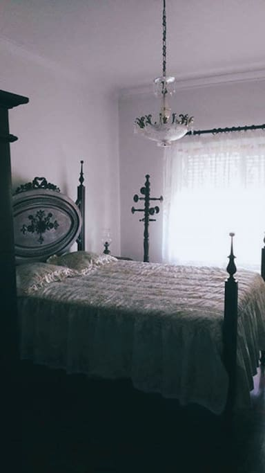 Double Room, with wardrobe. Very Spacious, with vintage decoration and the window connects with the Terrace.