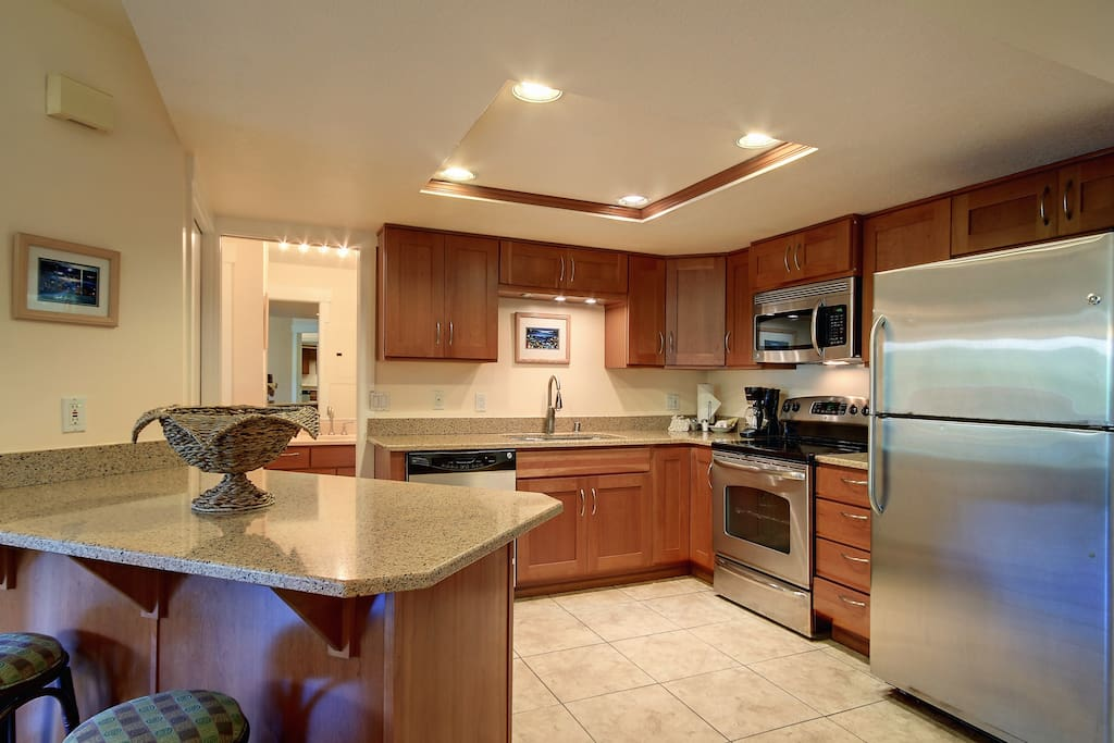 Large kitchen for cooking meals at home.