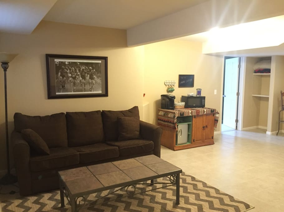 Lazy boy couch and TV in living room area