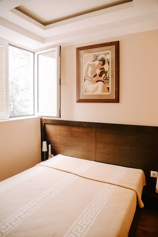 Bedroom overlooks an internal garden with a magnificent pomegranate tree
