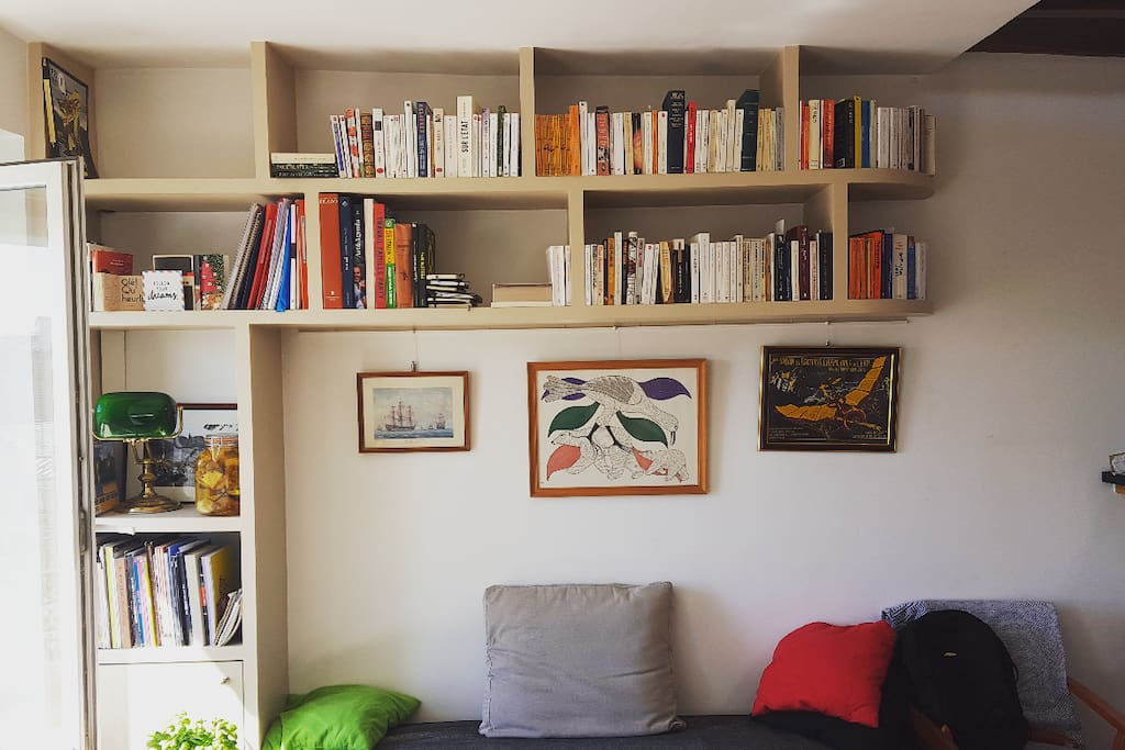 The main living room is full of books and lit all day by natural light. Feel free to pick & read if the weather's no good :)