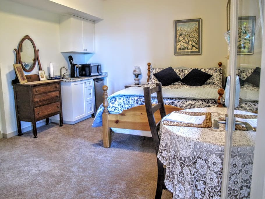 Lovely studio suite with comfy pillow top queen bed- kitchenette- private entry- private bathroom and patio.