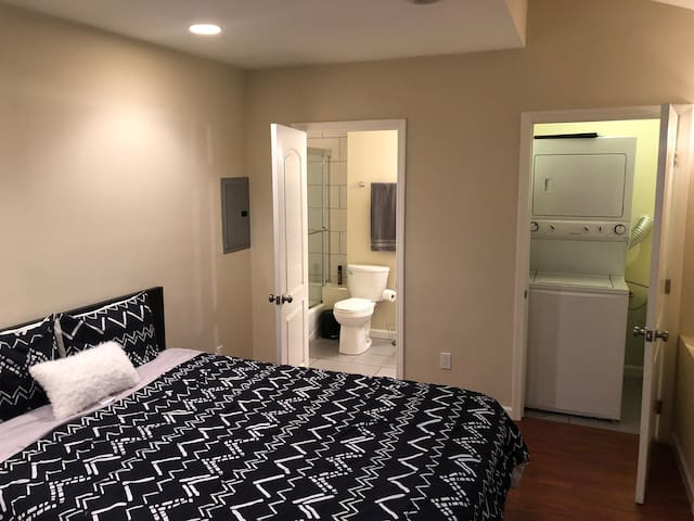Bedroom with bathroom and washer/dryer