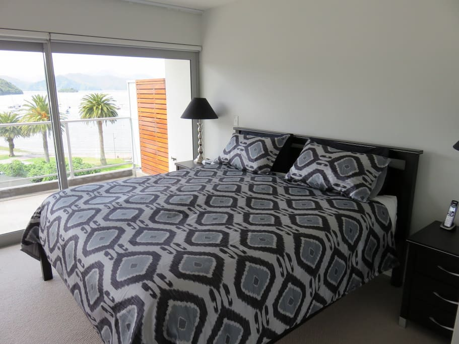 Master bedroom with super king bed, overlooking the harbour.