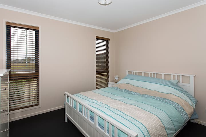 The second bedroom with queen bed