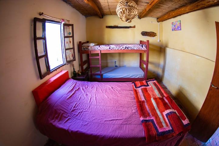 Habitación triple o cuádruple con baño compartido