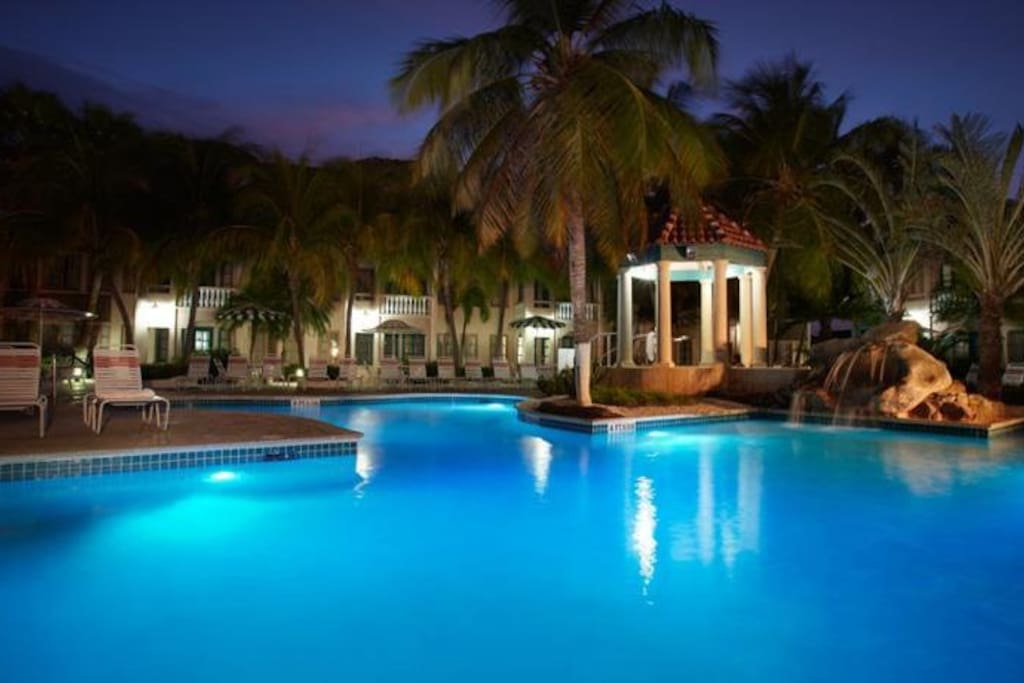 Aruba offers perfect temps for a dip after dark.... Both pools light up at night too!