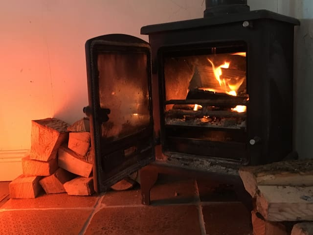 Cosy up to open fire ...  you bring the book, we'll supply the wood.