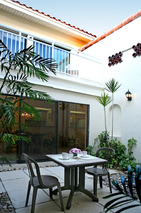Each unit has a private courtyard on the first floor and balcony on the second floor with patio furniture.