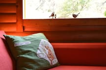 Another perspective of the pull-out sofa bed in the main cabin. Perfect for reading and looking out the window.