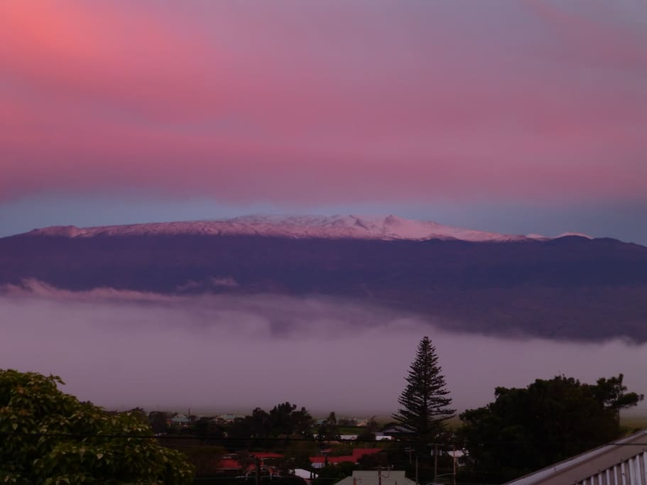 View of snow-capped Mauna Kea in the sunset