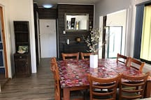 Dining area leading to the bathroom, back door and laundry facilities.