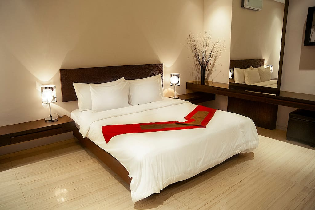 Bedroom 1 features with air conditioned, King size bed and dressing table.