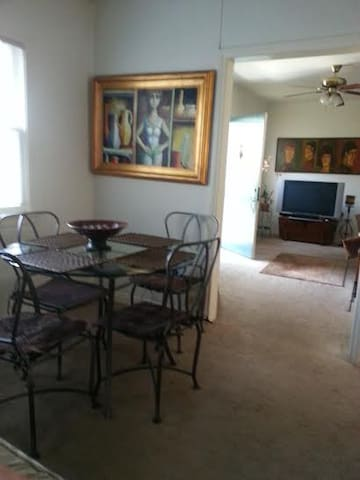 Shared open dining and living space.