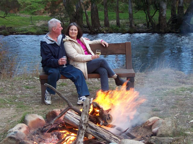 Enjoy a campfire by the river edge