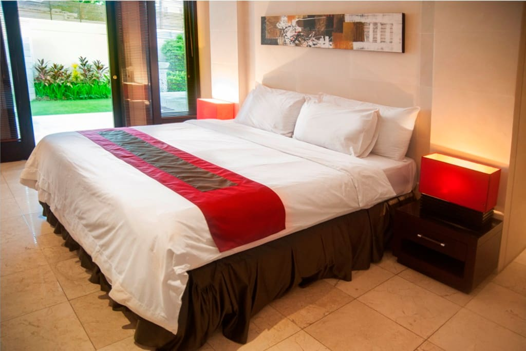 en-suite king size bedroom with air-conditioined