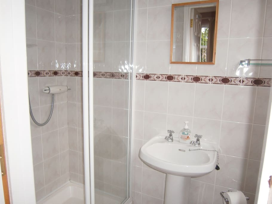 Ensuite shower room with each bedroom
