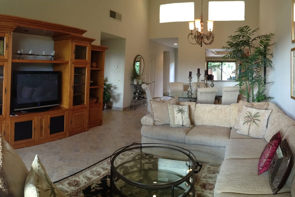 Living room with big-screen TV, and entertainment center